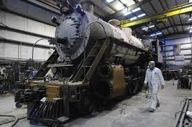 David Pugh works on a steam-powered locomotive at the Tennessee Valley Railroad shop in 2010.