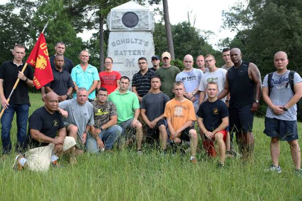 The Marines of Battery M, 3rd Battalion, 14th Marine Regiment pose for a picture with Col. Joseph Russo, commanding officer of 14th Marine Regiment, in front of Schultz's Battery M monument at Chickamauga and Chattanooga National Military Park in Fort Oglethorpe on Monday. U.S. Marine Corps photo by Cpl. Sara Graham.